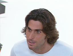 """Alexis Dupuy et sa fameuse coiffure de """"beau gosse""""."""